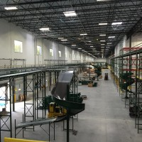 Automated warehouse material handling system