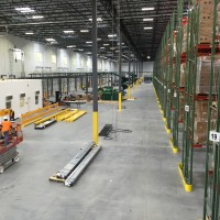 Warehouse design with shelving systems