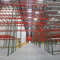 Warehouse over aisle selective rack
