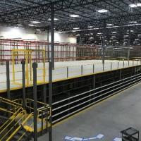 Warehouse pick module and mezzanine